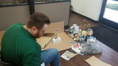 Working hard on their Earth Day project of re-using trash to build a sculpture, the Weekend Warriors at Intelicare Direct are building an homage to the Pacific Patch, a giant floating island of trash in the Pacific Ocean.