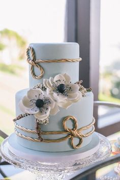 Pastel Blue Cake with Gold Rope    Photography: Krista Mason Photography    Read More:  http://www.insideweddings.com/weddings/romantic-seaside-styled-shoot-in-california-by-sterling-engagements/653/