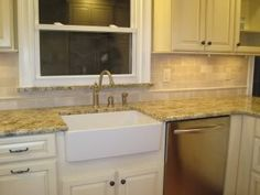 Santa Cecelia granite, white cabs, and neutral backsplash