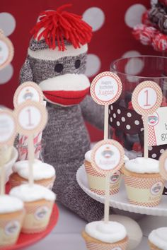 Sock Monkey 1st birthday party idea via Kara's Party Ideas - www.karaspartyideas.com. Such cute cupcake toppers!