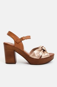 b1b6e92068b Elevate your warm-weather ensembles with this pair of platform sandals. The  brown leather