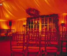 A romantic amber glow envelopes the entire room, creating a feeling of warmth at this winter wedding ceremony.