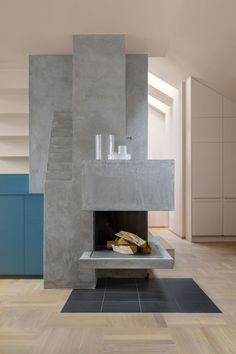To inform the color palette for this interior renovation in Stockholm, NOTE Design Studio began with three inspirational images. The sculptural fireplace, covered in plaster, contrasts with oak parquet floors. Concrete Fireplace, Farmhouse Fireplace, Faux Fireplace, Modern Fireplace, Fireplace Design, Fireplaces, Fireplace Seating, Fireplace Kitchen, Traditional Fireplace