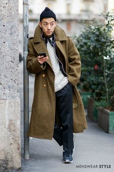 We snap his dapper chap wearing a Crombie overcoat for this fisherman style outfit on the streets of Milan during fashion week.