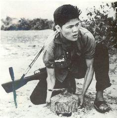 Rare photo of a member of the Viet Cong, laying a land mine. Exact date unknown, Vietnam  - Imgur