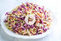 How to make our seriously good homemade coleslaw recipe. Apple cider vinegar and mustard makes our slaw anything but dull. With recipe video! Coleslaw Salad, Coleslaw Dressing, Creamy Coleslaw, Vinegar Coleslaw, Potato Salad Recipe Easy, Hummus Recipe, Homemade Coleslaw, Coleslaw Recipes, Kfc