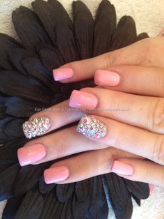 Full set of acrylic with pink polish and Swarovski crystals on ring finger