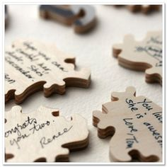 Each guest signs a puzzle piece - Afterwards, the couple puts the whole thing together :) glue & frame for your bedroom or living room