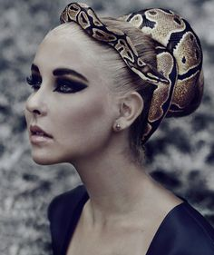 Awesome eye makeup and a snake in the hair....