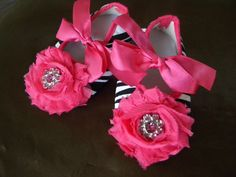 "Zebra flower shoes, birthday shoes. size 5 baby shoes, 12-18m shoes,  hot pink flower crib shoes, baby flower shoes, 5"" in length. $14.95, via Etsy."