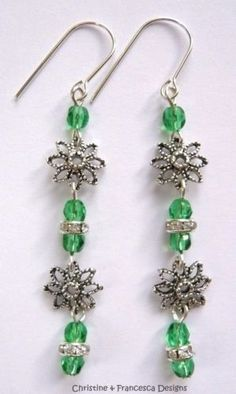 <3 Choice of 2 colours <3 Colour shown is Emerald Green and Clear Crystal Rondelle ♥ .925 Sterling Silver Faceted Czech Glass Crystal Rondelle and Flower Long Drop Hook Earrings + Gift Box & Organza Gift Bag ~ by Christine & Francesca Designs ---- #handmade #handcrafted #crystal #czech #silver #jewellery #hook #earrings #dangle #emerald #green #clear #rondelle #flower #flowers #glass #sterling