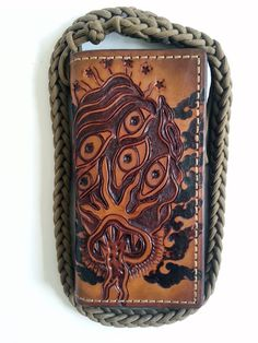 Hand tooled Shoggoth monster biker wallet by LabrysLeatherworks