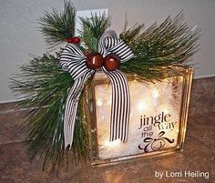 Lighted Glass Blocks, I made one different than this one, for Christmas; using Christmas fabric with a handmade bow.very easy to do.stuff twinkle lights in the blocks.you can buy the blocks already pre drilled at Hobby Lobby. Winter Christmas, All Things Christmas, Christmas Holidays, Merry Christmas, Christmas Decorations, Christmas Ornaments, Christmas Lights, Christmas Collage, Christmas Glass Blocks