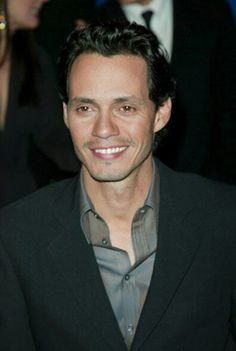 Marc Anthony an amazing singer great vocal cords. I saw him in a Puerto Rican parade in NY  he seems cool since i really didn't get a chance to interact with him. He was to busy singing  on a float.