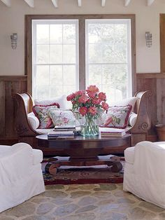 Classic Country Rooms: From tried-and-true blue-and-white palettes to vintage collections and creative repurposing, country decorating never goes out of style. Choose from a variety of lived-in, cozy looks and add comfort to every room of your house. By Andrea Cooley. Floral Style:   An antique daybed gets the royal treatment when piled with cushions in front of large windows. Worn draperies were repurposed as colorful throw pillows that pop against the natural wood tones. Fieldstone floors add rustic style to the room while a bouquet of fresh peonies, straight from the garden, lends country charm.