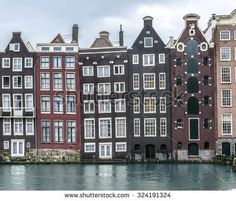 stock-photo-traditional-dutch-medieval-buildings-in-amsterdam-netherlands-324191324.jpg (450×385)