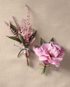 Shimmering Boutonnieres Light up your groom's lapels with a sprig of astilbe or a couple of garden lisianthus threaded onto a Tinsel Trading metal bead. Tie it all together with Mokuba New York metallic tape (212-869-8900).