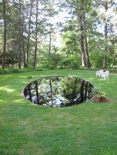 Black reflecting pool in the grounds of Montgomery Place, NY by N.Meek