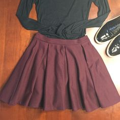 "Pleated Topshop skirt About 16"" long, fitted at the waist band with a few pleats extending from there. Fastens in the back with an exposed zipper. Dark burgundy in color. 96% polyester and 4% elastic. Topshop Skirts Circle & Skater"