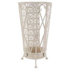 A charming addition to your country porch or rustic hallway, this metal umbrella stand features a floral design and cream finish. Team with pastel tones, painted woods and fresh blooms for a sense of vintage elegance.   Product: Umbrella holderConstruction Material: MetalColour: CreamFeatures: Scrollwork motifDimensions: 46 cm H x 25 cm Diameter