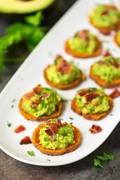white platter of bacon and avocado topped Baked Sweet Potato Bites appetizer
