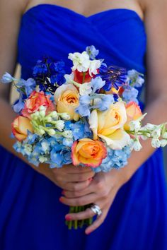Favorite roses and the perfect color blue - maybe have a super pale pink or lavender rose or peonies instead of the orange..