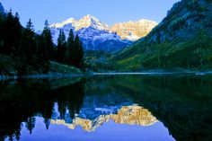 Explore the Maroon Bells: What You Need to Know | A reflective lake and two giant snow-striped mountaintops, named Maroon Peak and North Maroon Peak, anchor a blissful panorama exemplified by a symphony of color that changes with the seasons.