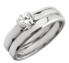 Round cut rub over engagement ring and wedding ring set by www.diamondsandrings.co.uk RBC191