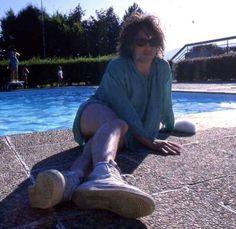 """Robert Smith on the edge of the deep """" pool """" sea"""
