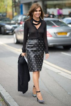 The quickest way to mimic Carine Roitfeld's signature edgy-sleek style might just be with a leather pencil skirt and black blouse.