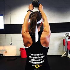 It's not the size of the girl in the fight. It's the size of the FIGHT in the girl. Tanks at: motivatehopestrength.com #fitness #motivation #gymtees #workout #gymapparel #motivational tees #fight in the girl #like A girl #strong #IFBB #bodybuild #weight train #women's health #health and Fitness #FITSPO #fitblr #gym girl #women lifting #strength training #squat #exercises