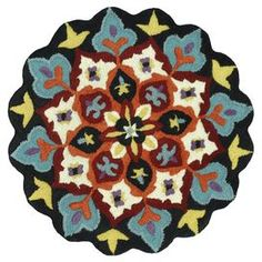 "Create a captivating focal point in your home with this lovely hand-tufted wool rug, featuring an eye-catching floral motif and a scalloped silhouette. Made in India.     Product: RugConstruction Material: 100% WoolColor: Black and ivoryFeatures: Handmade in IndiaPile Height: 0.5""Dimensions: 3' Round Note: Please be aware that actual colors may vary from those shown on your screen. Accent rugs may also not show the entire pattern that the corresponding area rugs have.Cleaning and Care: ..."