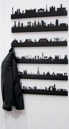 Laser etched landmark skyline on wall mounted coat rack by Radius Design
