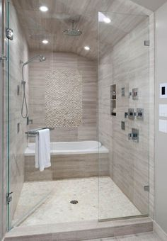 BATH in Shower area... Add Steam :)) Standing white pebble tile on shower wall and white pebble tile on shower floor. by katheryn