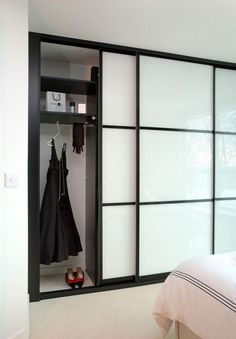 Amazing Sliding Door Wardrobe Design Ideas Built-in wardrobes offer convenience to many households. A built-in wardrobe saves up a lot of space and gives your home … Sliding Bedroom Doors, Sliding Door Wardrobe Designs, Modern Closet Doors, Sliding Door Design, Wardrobe Design Bedroom, Bedroom Cupboard Designs, Bedroom Furniture Design, Bedroom Decor, Wardrobes With Sliding Doors