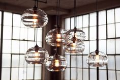 John Pomp Clear Band Pendant Lights >>> Handblown glass with retro Bulbrite bulb. Very sculptural and individual. On the practical side, you need more than one of these pendants to get any illumination - Bulbrite bulbs are only rated at Dining Room Lighting, Home Lighting, Lighting Design, Pendant Lighting, Pendant Lamps, Blown Glass Pendant Light, Glass Pendants, Dining Room Centerpiece, Light In
