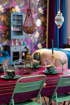 Love the colorful candle holder hanging above the table.