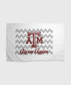 "This white pillow case has a grey chevron pattern on it with a block ATM and reads ""Gig 'Em Aggies"" in maroon. 50% cotton, 50% polyester. Fits a standard pillow case."