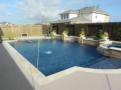 Love the stone and tile, a little less formal than the other pool I love