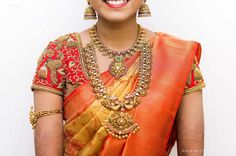 South Indian bride. Gold Indian bridal jewelry.Temple jewelry. Jhumkis.Yellow and orange silk kanchipuram sari.braid with fresh jasmine flowers. Tamil bride. Telugu bride. Kannada bride. Hindu bride. Malayalee bride.Kerala bride.South Indian wedding.
