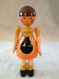 """6.5"""" painted wood Lise toy figure, with wire-jointed arms, stamped """"Made in Denmark"""" beneath skirt, with maker's label and remnants of price sticker on the bottom of the foot, Denmark, 1930-40, by Kay Bojesen."""