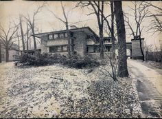 """Daily News photo dated 2/12/75 - Raymond W. Evans House, / 9914 South Longwood Drive, Chicago IL / 1908 / Prairie / Frank Lloyd Wright --The house is based on Frank Lloyd Wright's design for """"A Fireproof House for $5,000"""", published in April 1907 an article for the Ladies Home Journal. This was Wright's third and final publication in the journal following """"A Home in a Prairie Town"""" and """"A Small House with 'Lots of Room in It'"""" from February and July 1901, respectively."""