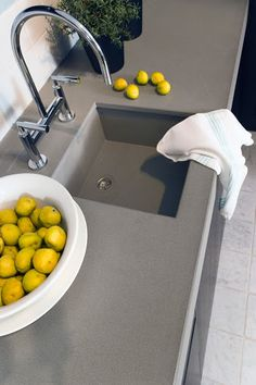 Polished Medium Grey kitchen worktops. Love it against the yellow lemons.