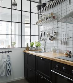 Glass wall between kitchen and bedroom - via cocolapinedesign.com