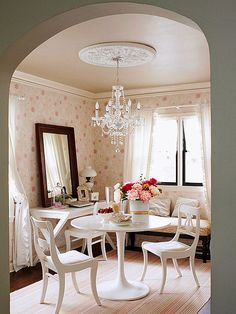 Architectural touches don't have to pricey or overdone. Here, a polystyrene ceiling medallion and a crystal chandelier give the dining room an air of both fun and formality./