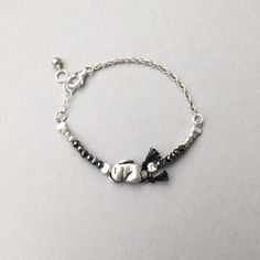 """Tiny Sleeping Bunny, made to rest on your wrist! This darling bracelet features a pure silver, handmade bunny charm adorned with dark & bright silver pyrite beads combined with a sterling silver chain. Size 6.75"""" ( $69) #animaljewelry #daintyjewelry #minimalistjewelry"""