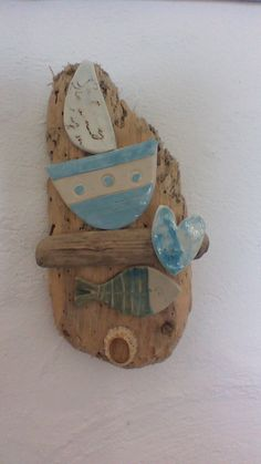 From Skellig pottery, driftwood and handmade boat and fish.