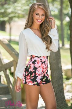 This dazzling floral romper is perfect for your next backyard party or girls night out! Featuring a bold pink, green, and white floral print paired with black fabric and a white top, this classic combination will stand out in a crowd!