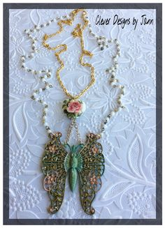 Challenge .. Spring Has Sprung .. Butterfly is painted with Perfect Pearls and Lumiere paints .. Butterfly dangles under a beautiful Rose Heart .. Rosary and Gold Plated Chain complete this beauty .. Clever Designs by Jann .. https://www.etsy.com/shop/CleverDesignsbyJann
