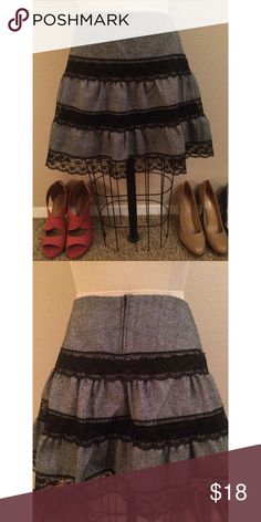 """Lace Tier Flare Skirt Super girly and perfect for the fall. Just a touch of lace. Fully lined. It sits pretty high on your waist as well. You can wear with stockings, leggings, or alone. Was only worn twice and is in perfect condition. Zipper is probably 5-6"""" long. I'm looking for someone who might appreciate this more than me. :) ask any questions!  Check out my page for more cute stuff! I mostly sell clothing/accessories/jewelry/makeup!  Skirts Mini"""